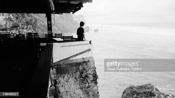 Side View Of Man Standing At Restaurant By Sea