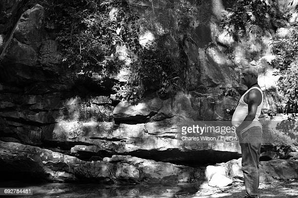 side view of man standing by rock formations at oak mountain state park - pelham alabama stock pictures, royalty-free photos & images