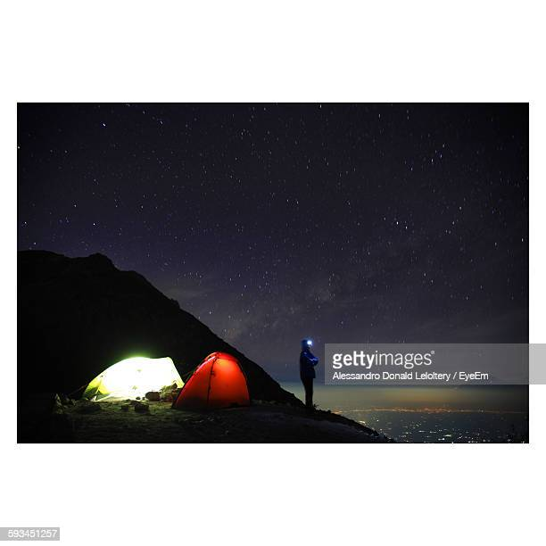 Side View Of Man Standing On Mount Sumbing Against Star Field