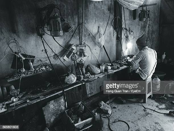side view of man working in workshop - hong quan stock pictures, royalty-free photos & images