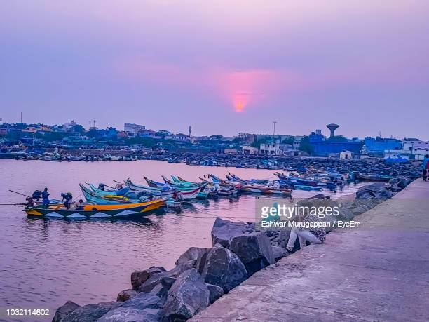 side view of mature man looking at sea while siting against cloudy sky during sunset - chennai stock pictures, royalty-free photos & images