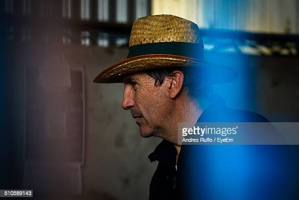Side view of mature man wearing straw hat