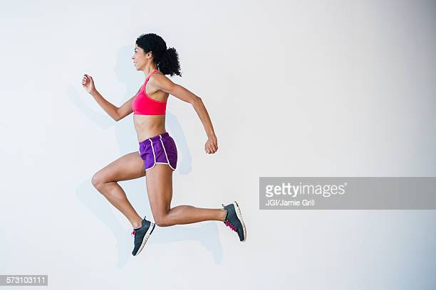 Side view of mixed race woman running