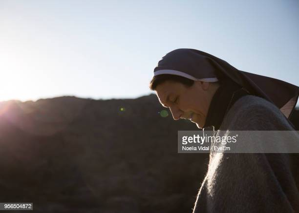 side view of nun against clear sky - nun stock pictures, royalty-free photos & images