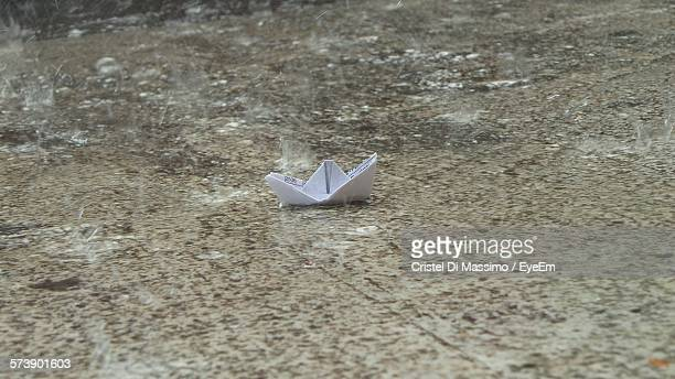Side View Of Paper Boat In Shallow Water