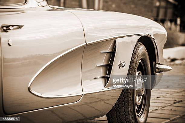 side view of parked chevrolet corvette convertible 1959 sepia toned - chevrolet corvette stock pictures, royalty-free photos & images