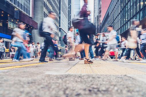 side view of pedestrains rush in Hong Kong - gettyimageskorea