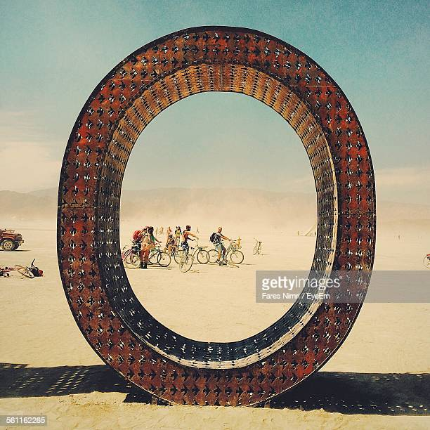 Side View Of People Bicycling In Desert