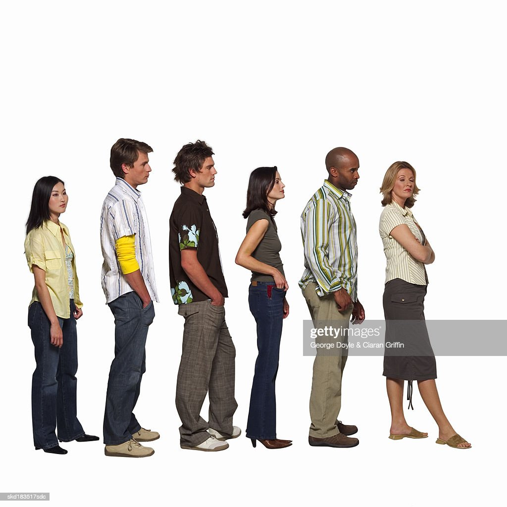 Side view of people in a queue : Stock Photo