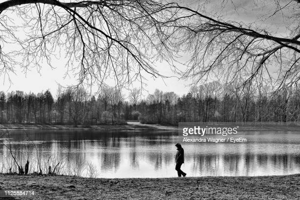 Side View Of Person Walking By Lake