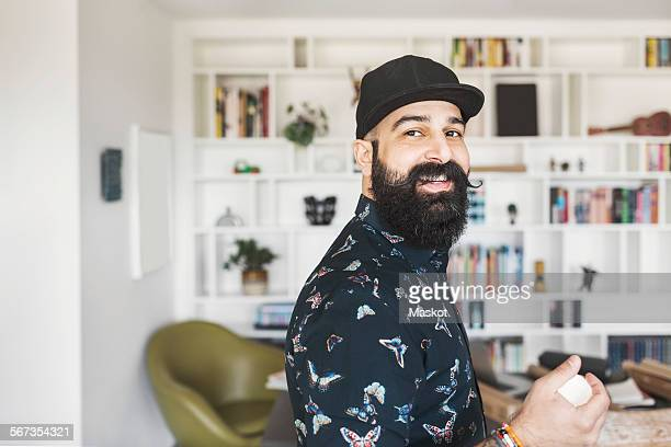side view of portrait of happy male architect standing in home office - beard stock pictures, royalty-free photos & images