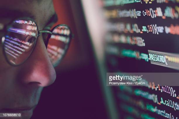 side view of programmer looking at binary code in office - computer language stock pictures, royalty-free photos & images