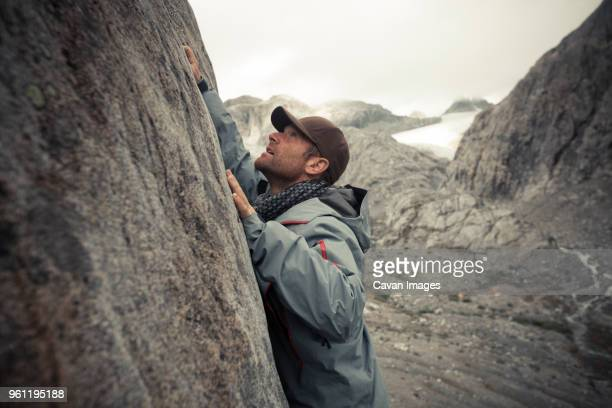 side view of rock climber by mountain at garibaldi provincial park - garibaldi park stock pictures, royalty-free photos & images