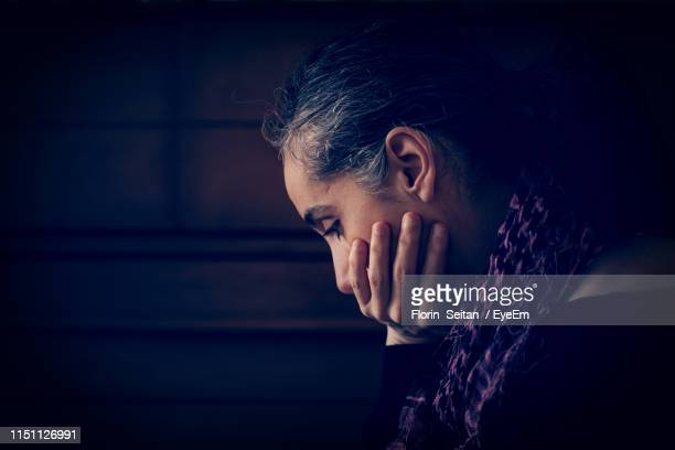 side view of sad woman - florin seitan stock pictures, royalty-free photos & images