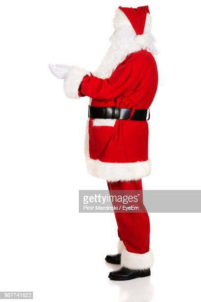 Side View Of Santa Claus Standing Against White Background