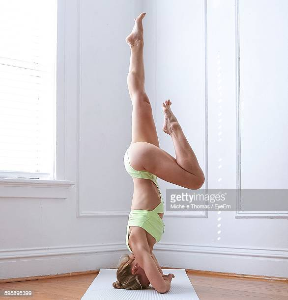 Side View Of Seductive Woman Doing Yoga At Home