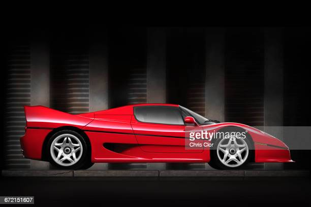 side view of shiny red sports car - muscle car stock photos and pictures