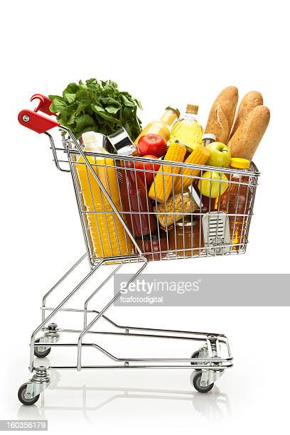 side view of shopping cart filled with groceries and vegetables - full stock pictures, royalty-free photos & images