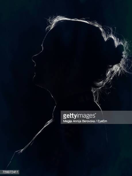 side view of silhouette woman against black background - back lit stock pictures, royalty-free photos & images