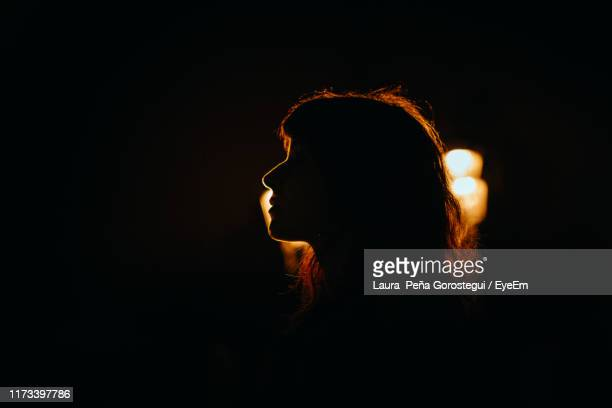 side view of silhouette woman against illuminated light - back lit stock pictures, royalty-free photos & images