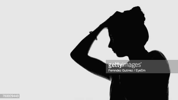 side view of silhouette woman against white background - shadow forms stock photos and pictures