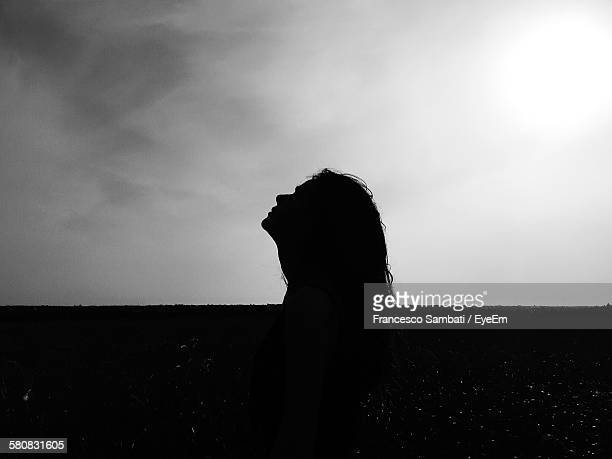 Side View Of Silhouette Woman Standing On Field