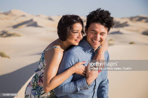 side view of smiling couple at desert - chihuahua desert stock pictures, royalty-free photos & images