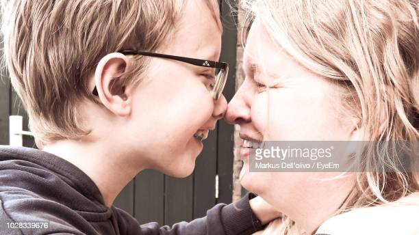 Side View Of Smiling Mother And Son
