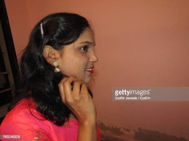 side view of smiling young woman at home - at home ストックフォトと画像