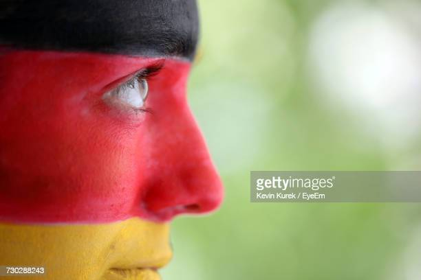 side view of soccer fan with german flag painted on face - fan enthusiast stock pictures, royalty-free photos & images