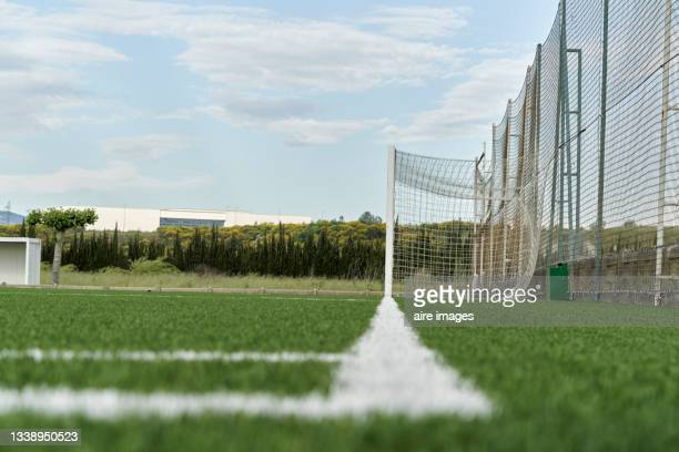 side view of soccer goal into green grass at a sunny day - international team soccer stock pictures, royalty-free photos & images