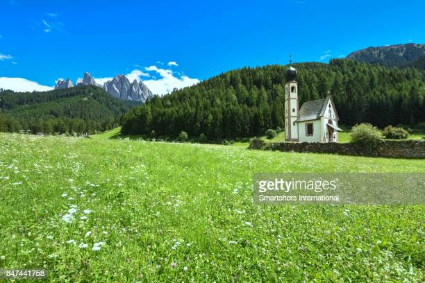 Side view of St Johann Ranui chapel in Val di Funes Valley, Puez-Odle Natural Park, a UNESCO Heritage site in, South Tyrol, Italy