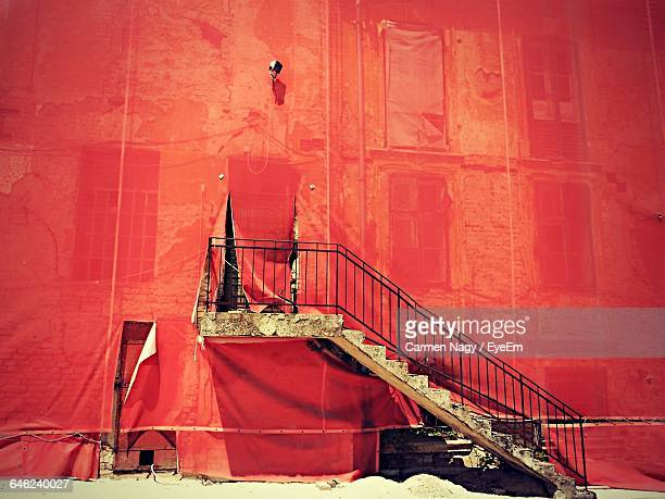 Side View Of Stairs Against Red Covering