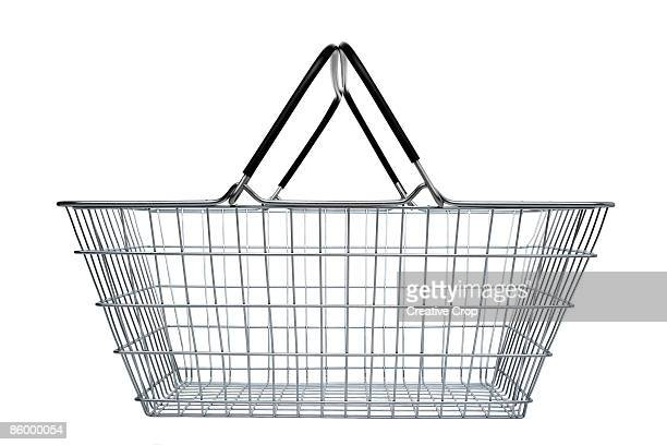 side view of steel wire shopping basket - basket stock photos and pictures