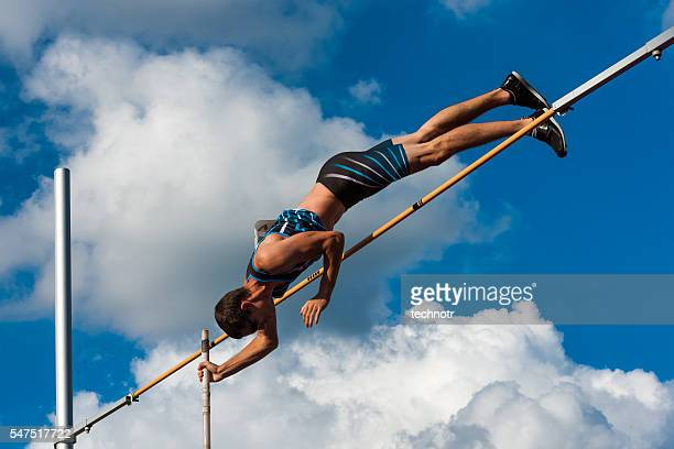 side view of succsesfull jump - men's field event stock pictures, royalty-free photos & images