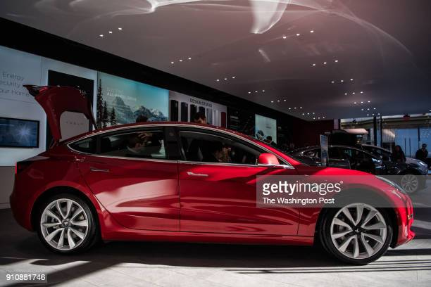 A side view of Tesla's new Model 3 car on display is seen on Friday January 26 at the Tesla store in Washington DC