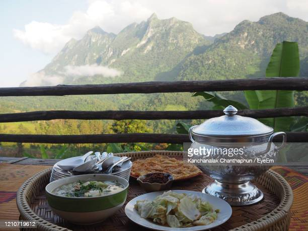 side view of thai food traditionally dinner with moutains background - northern rail stock pictures, royalty-free photos & images