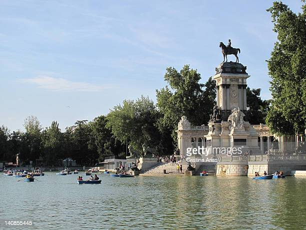 Side view of the pond of the Retiro Park and the sculptural group dedicated to King Alfonso XII, Madrid, Spain, August 2011.