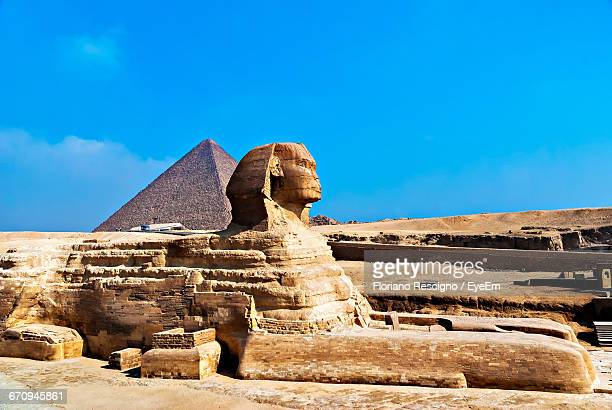 Side View Of The Sphinx Against Pyramid In Egypt