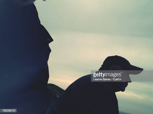 Side View Of Thoughtful Man Against Cloudy Sky