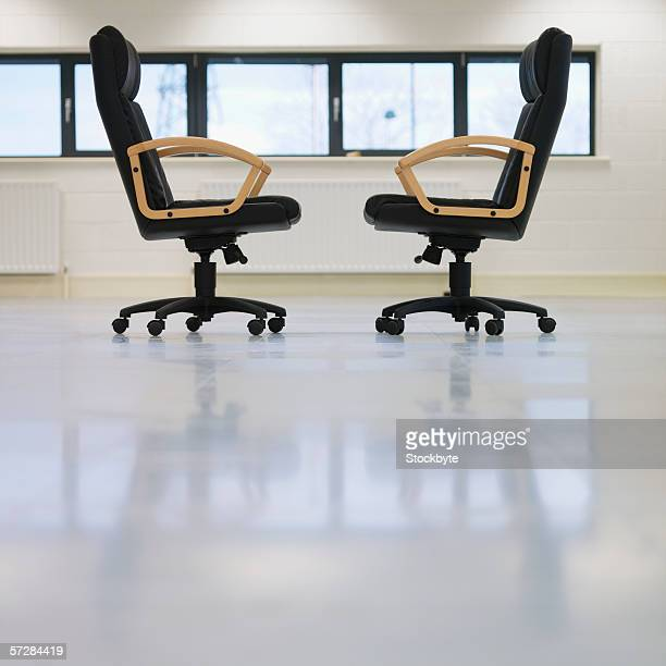 Side view of two office chairs facing each other