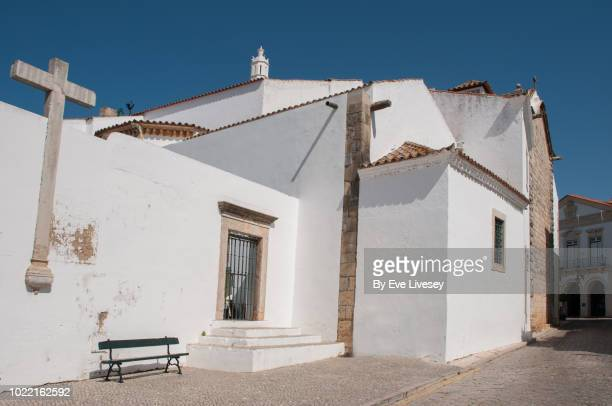 side view of virgin mary's cathedral - faro city portugal stock photos and pictures
