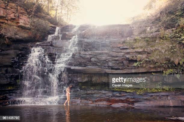 Side view of woman at waterfall at Chapada Diamantina National Park