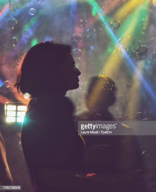side view of woman by bubbles in nightclub - incidental people stock pictures, royalty-free photos & images