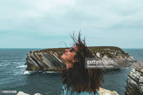 Side View Of Woman By Sea Against Sky