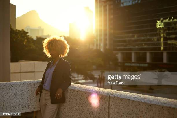 side view of woman during the sunset - golden hour stock pictures, royalty-free photos & images