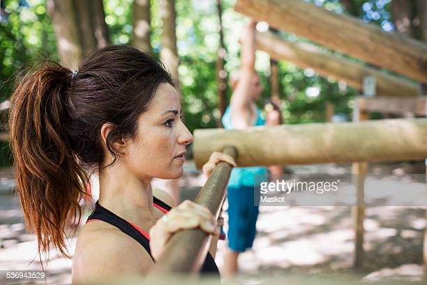 Side view of woman exercising at outdoor gym