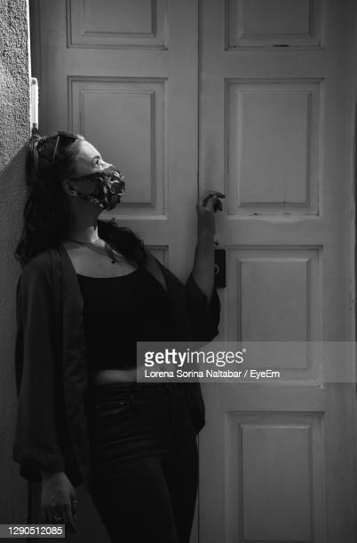 side view of woman holding closed door - lorena day stock pictures, royalty-free photos & images