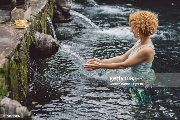 side view of woman in water - bortes stock pictures, royalty-free photos & images
