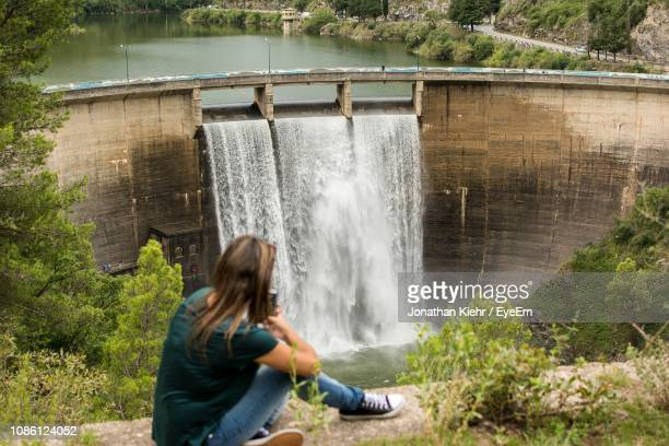 side view of woman looking at dam - cordoba argentina stock photos and pictures